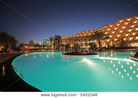 Night Pool And Hotel