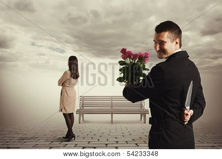 perfidious man with knife and flowers going to meeting