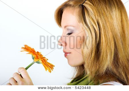 Young Woman With A Flower