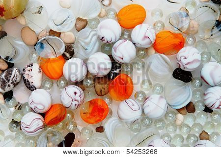 Abstract background from color and transparent glass balls and beads closeup poster