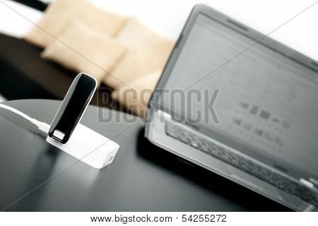 Mobile Wireless Internet Router And Laptop On The Table