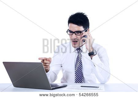 Young Businessman Is Shouting By Phone
