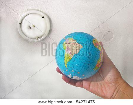 Woman hand holding globe.