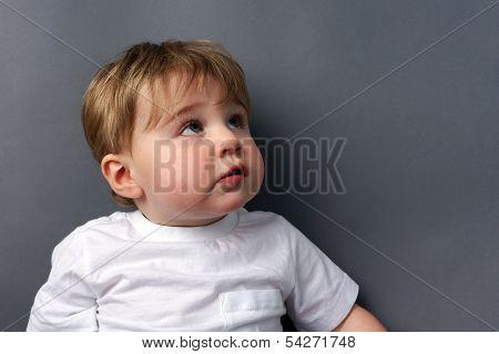 Little Boy Looking Up
