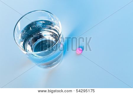 antidepressant pill and glass of water