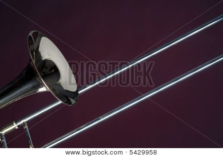 Trombone Close Isolated On Red