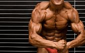 bodybuilder in front of wall poster