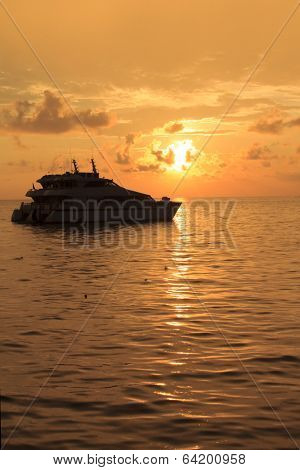 Luxury Liveaboard diving boat yacht at sunset