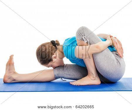 Yoga - young beautiful slender woman yoga instructor doing Forward Bends Sage Twist A pose (Marichyasana A) asana exercise isolated on white background