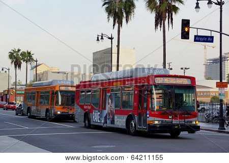 Metro Rapid Bus 757 Followed By A Local Bus 180 Rolls Down Famous Hollywood Boulevard