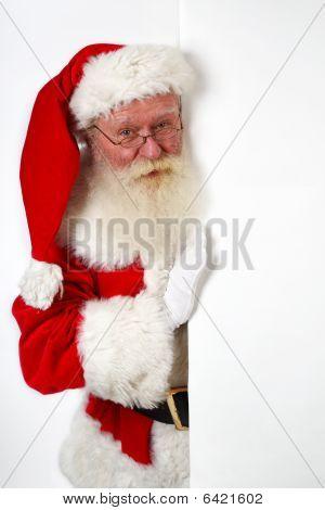 Santa Holding A Notice Board