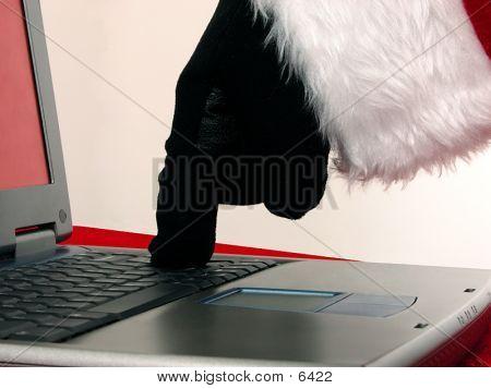 Santa Hand On Laptop Computer