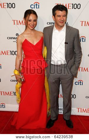 NEW YORK-APR 29: Entrepreneur Travis Kalanick & Gabi Holzwarth attend the Time 100 Gala for the Most Influential People at Frederick P. Rose Hall at Lincoln Center on April 29, 2014 in New York City.