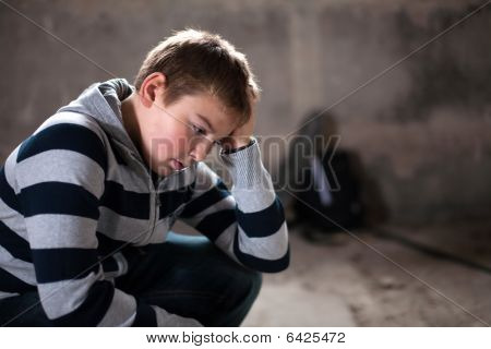 Problems Of Young Teenaiger Against Grunge Background With Skateboard And Shoulder Bag