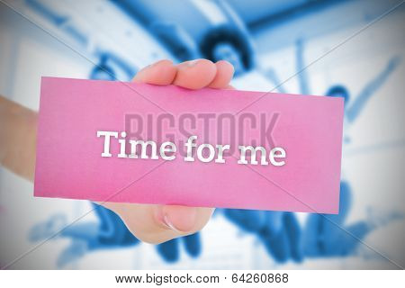 Woman holding pink card saying time for me against fitness class in gym poster