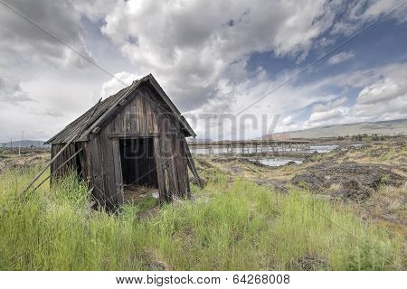 Old Abandoned Native American Fishing Shacks Along Columbia River by the Dalles Bridge in Oregon poster