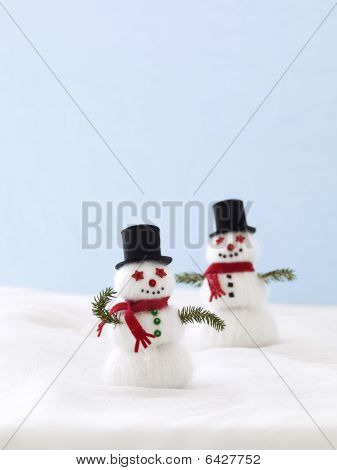 snowman's made from white yarn