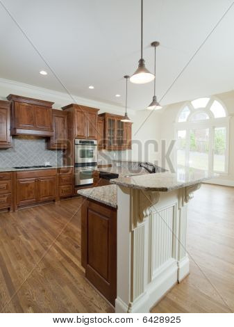 Model Luxury Home Interior Kitchen With Arch Window And Counter