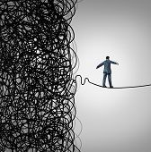 Crisis Management business concept as a tightrope walker walking out of a confused tangled chaos of wires breaking free to a clear path of risk opportunity as a metaphor for managing organizational challenges for financial freedom and success. poster