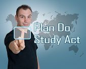 Young man press digital Plan Do Study Act button on interface in front of him poster