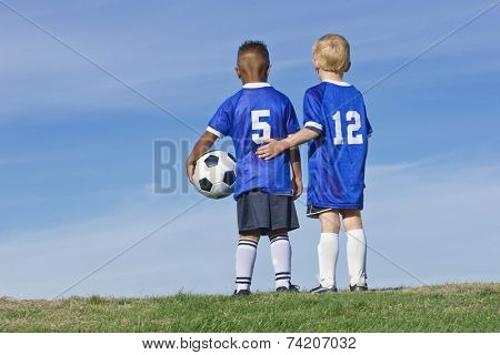 Youth Soccer Players standing together Rear View