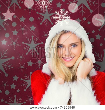 Pretty girl smiling in santa outfit against red vignette poster