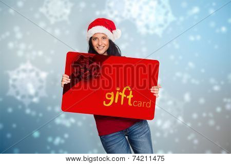Woman holding a white sign against digitally generated delicate snowflake design poster