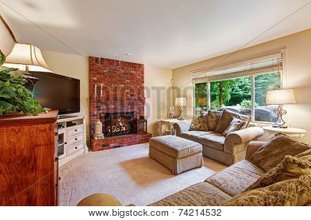 Cozy Living Room With Brick Fireplace