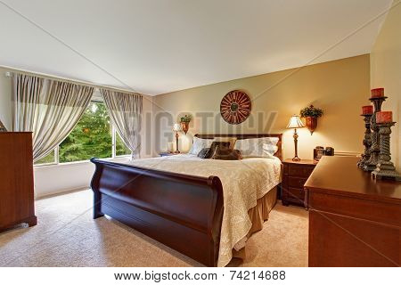Spacious Bedroom Interior With Nice Wooden Bed