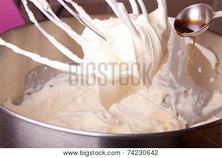 Pouring  Vanilla Extract To Cream