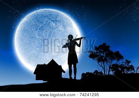 Silhouette of woman playing violin at night