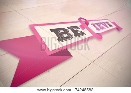 Breast cancer awareness message against bleached wooden planks background poster
