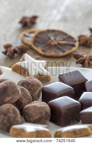 Pralines Of Chocolate And Marzipan And Cinnamon Stars