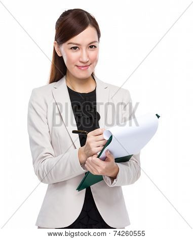 Business woman jot note on clipboard