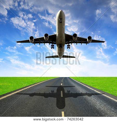 Landing passenger airplane in the sunset