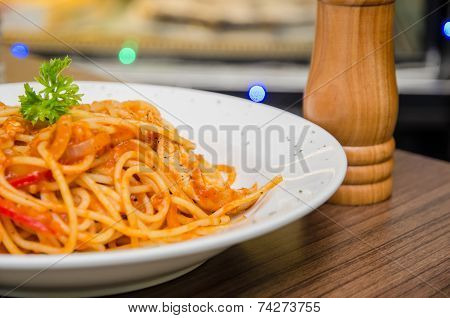 Spaghetti With Chicken Slices On A White Plate