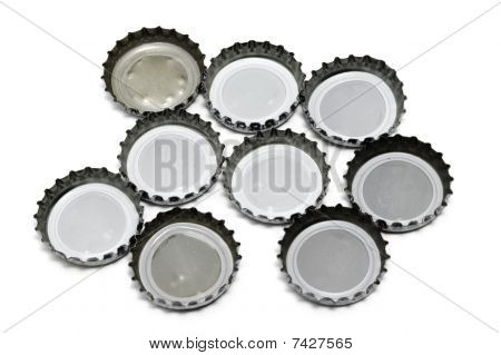 some crown caps isolated on a white background poster