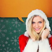 Pretty girl smiling in santa outfit against green vignette poster