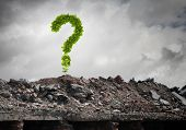 Conceptual image with green question mark growing on ruins poster