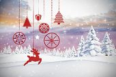 Hanging red christmas decorations against twinkling stars poster