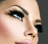 Beauty face makeup. Make up. Eyelashes extensions. Perfect Make-up closeup. Foundation. Cosmetic Eyeshadows, eyebrows. Beauty Girl with Perfect Skin. Eyelashes. Makeover  poster