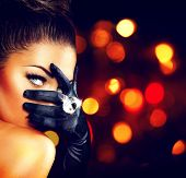 Beauty Fashion Glamorous Model Girl Portrait. Vintage Style Mysterious Woman Wearing black Glamour Gloves. Jewellery. Jewelry. Holiday Hairstyle and Make-up. Diamond Ring. Retro Lady with Blue Eyes  poster
