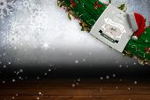 Sign with Merry CHristmas and Happy New Year against shimmering light design over boards poster