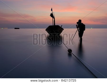 Photographer Is Taking A Photo Of A Fishing Boat