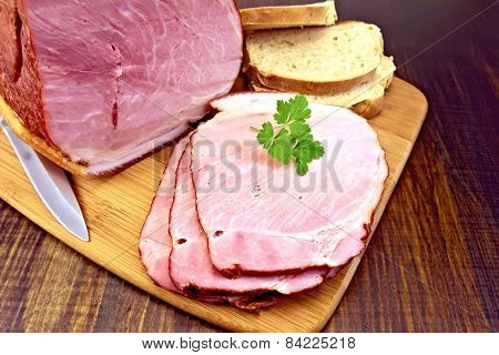 Ham smoked with bread on dark board
