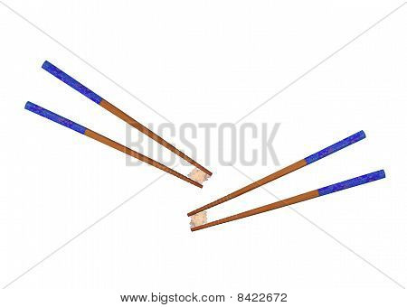 Chopsticks and a pinch of rice on a white background