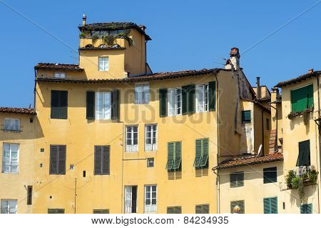 Lucca (Tuscany Italy) the famous medieval square known as Piazza Anfiteatro poster