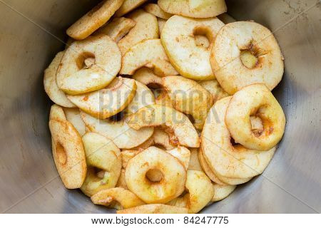 Many apple slices in metal pan