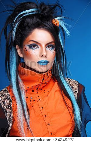 Makeup. Rock Hairstyle. Portrait Of Young Beautiful Punk Model With Blue Lips, Black Hair.