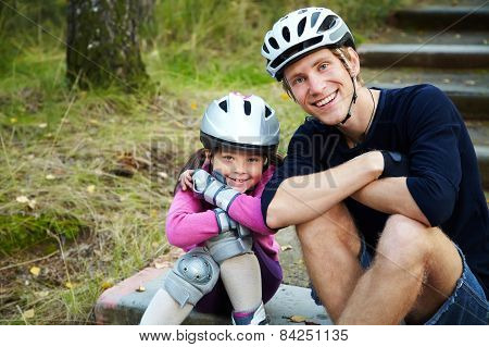 Dad and daughter in a helmet